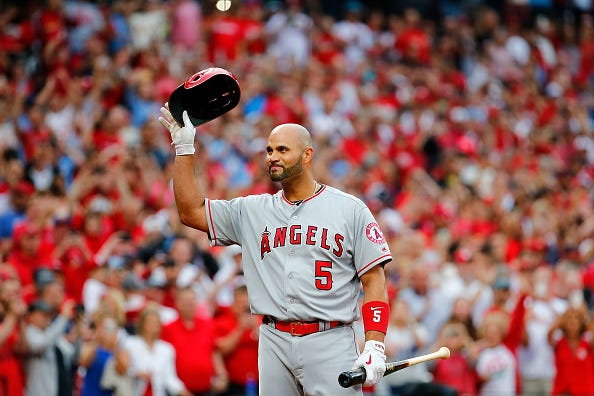 Albert Pujols salutes the Cardinals fans in his return to St. Louis.