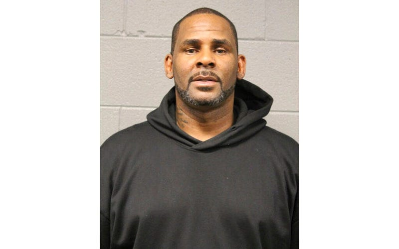In this photo taken and released by the Chicago Police Dept., Friday, Feb. 22, 2019, R&B singer R. Kelly is photographed during booking at a police station in Chicago, Ill.