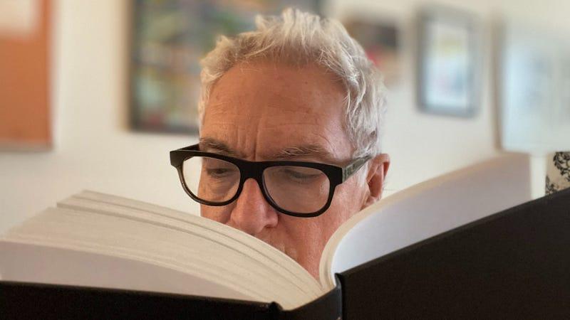 John reading a book