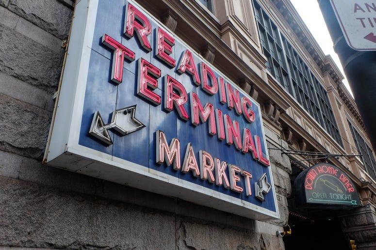 An exterior sign for Reading Terminal Market.