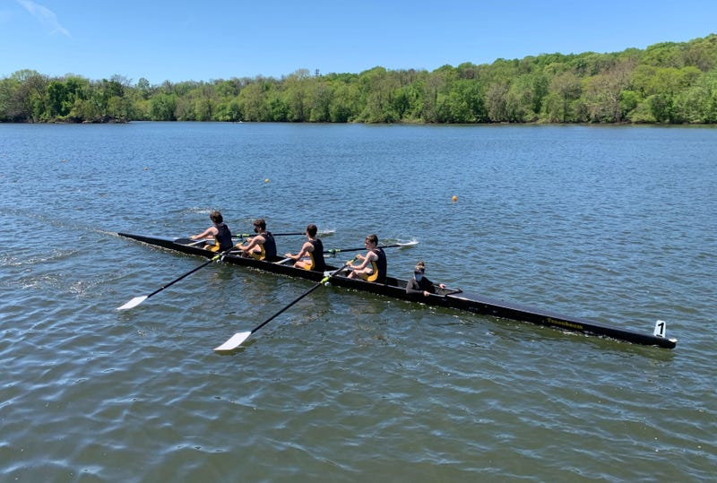 A team of high school rowers competes in the Philadelphia Scholastic Rowing Association City Championship on the Schuylkill River Saturday.