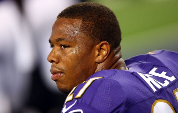 Ray Rice looks on from the Ravens sideline.