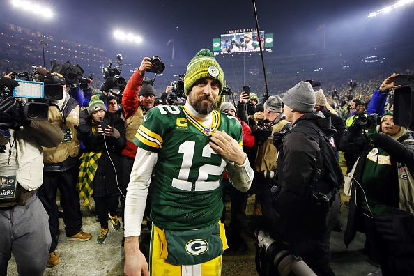 Aaron Rodgers grins after a Packers playoff win.