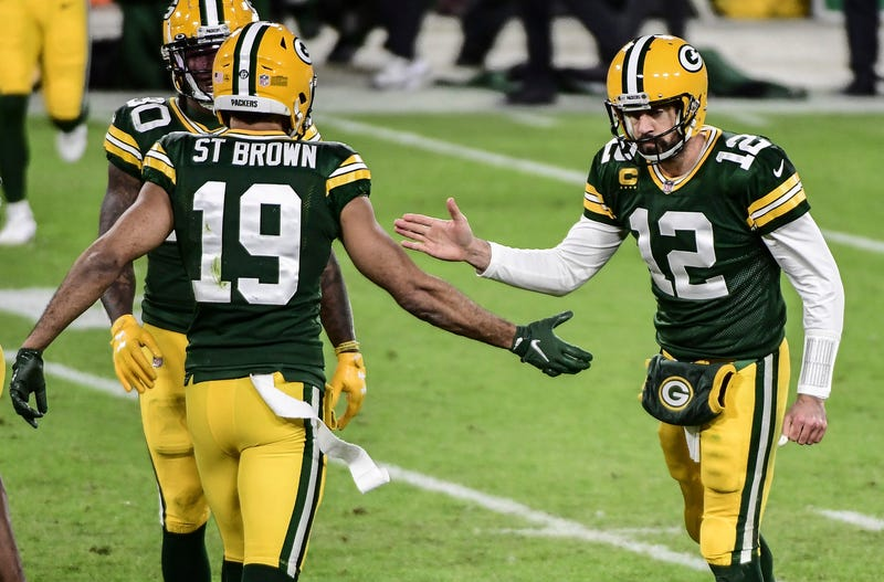 Nov 29, 2020; Green Bay, Wisconsin, USA; Green Bay Packers quarterback Aaron Rodgers (12) celebrates with wide receiver Equanimeous St. Brown (19) after clinching a victory against the Chicago Bears at Lambeau Field. Mandatory Credit: Benny Sieu-USA TODAY