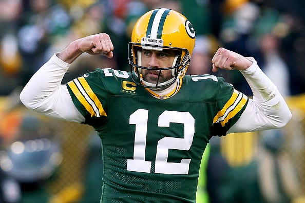 Aaron Rodgers flexes during a Packers win.