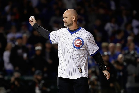 David Ross throws out the first pitch at a Cubs playoff game.