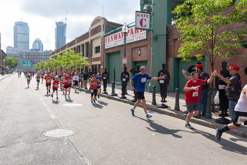Runners take part in the Run To Home Base fundraiser at Fenway Park