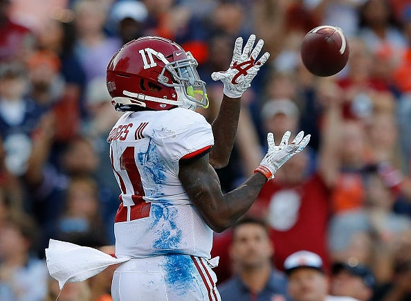 Henry Ruggs hauls in a pass for Alabama.