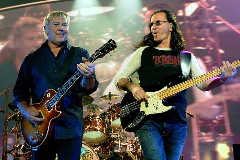 Alex Lifeson and Geddy Lee of Rush perform live in concert.