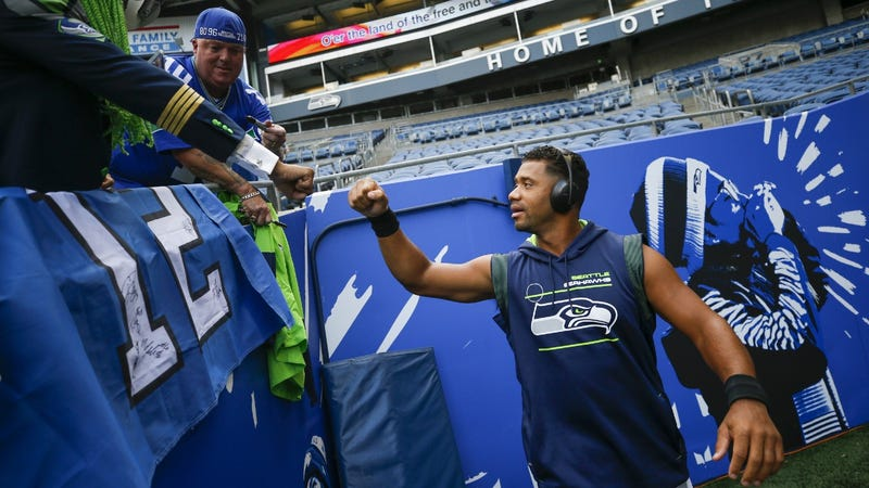 Russell Wilson fist bumps some 12s at Lumen Field