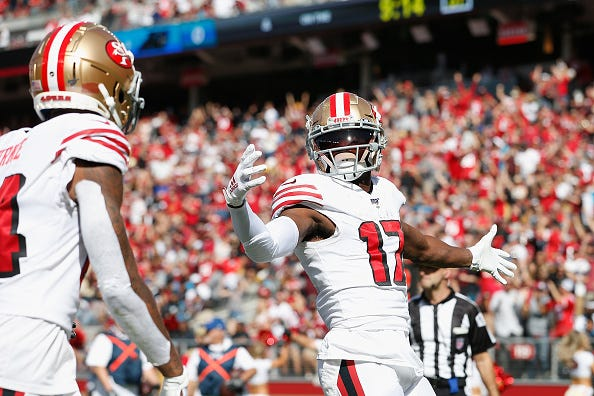 Emmanuel Sanders celebrates a TD in his first game with the 49ers.