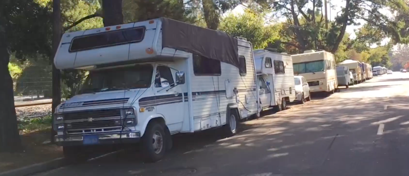 A row of RVs in Mountain View near the Caltrain tracks is not far from the new Google headquarters that is under construction.