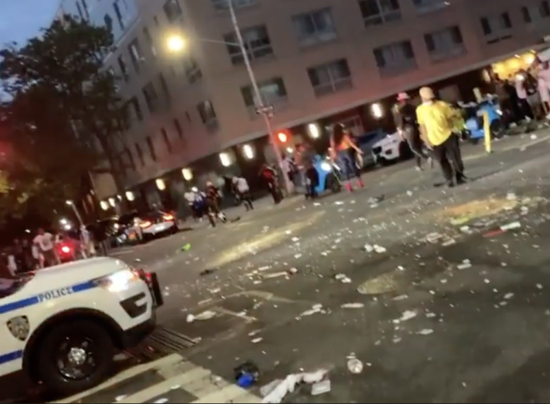 crowd throwing bottles in harlem