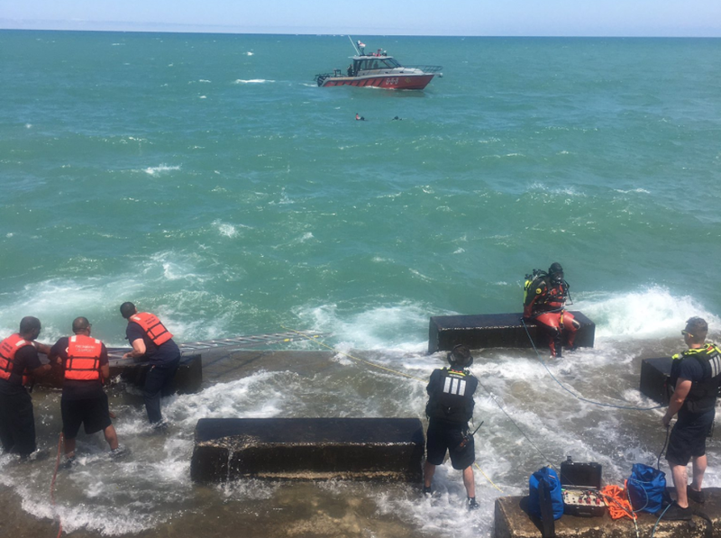 Divers search for a missing swimmer in Lake Michigan on July 17, 2020.