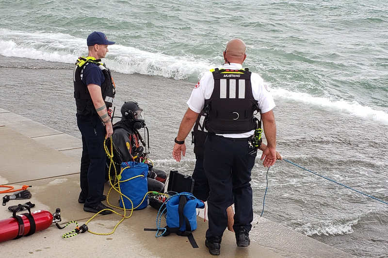 Divers Search For Teen At Diversey Harbor