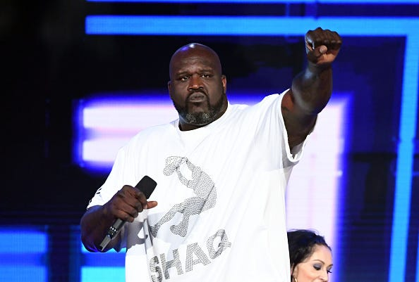 Shaquille O'Neal raps at the 2019 NBA Awards show.