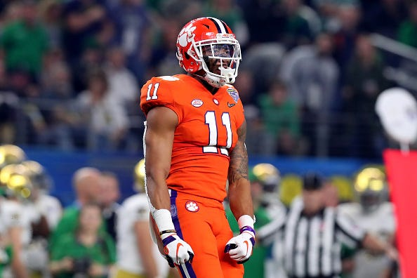 Isaiah Simmons flexes after a big play for Clemson.