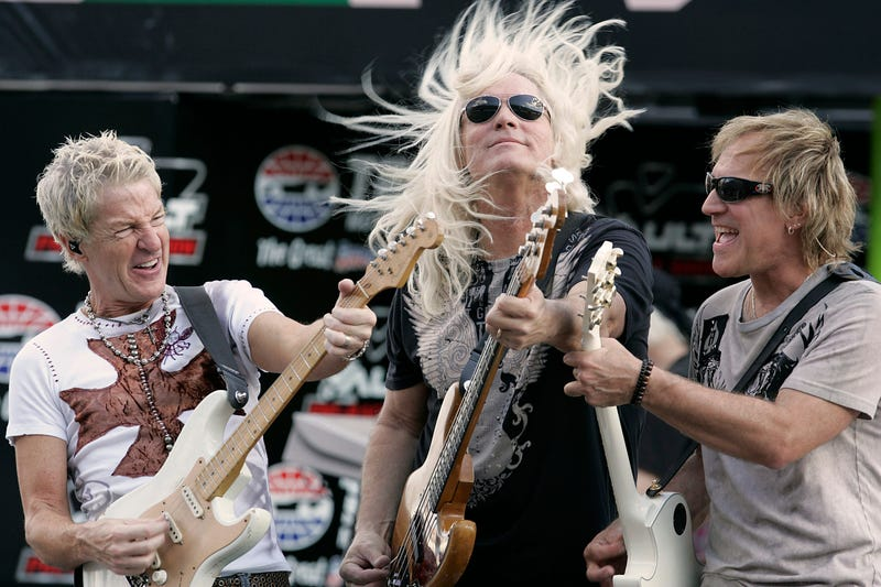 REO Speedwagon members Kevin Cronin, Bruce Hall, and Dave Amato perform before the start of the NASCAR Sprint Cup Dickies 500 on Sunday, November 2, 2008, at Texas Motor Speedway in Fort Worth, Texas. (Photo by Ross Hailey/Fort Worth Star-Telegram/MCT/Sip