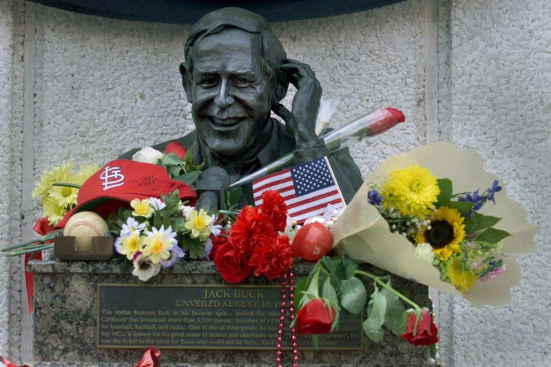 flowers and gifts adorn a bronze bust of the late Jack Buck, an announcer for the St. Louis Cardinals