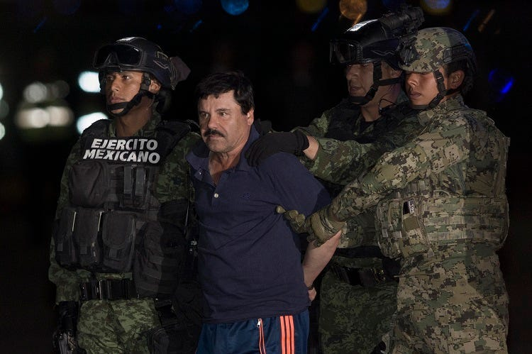"BEIJING, Jan. 10, 2016 (Xinhua) -- Soldiers escort Joaquin Guzman Loera, alias ""El Chapo"", upon his arrival to the hangar of the Attorney General's Office, in Mexico City, capital of Mexico, on Jan. 8, 2016. After an early morning raid in northwestern Mex"