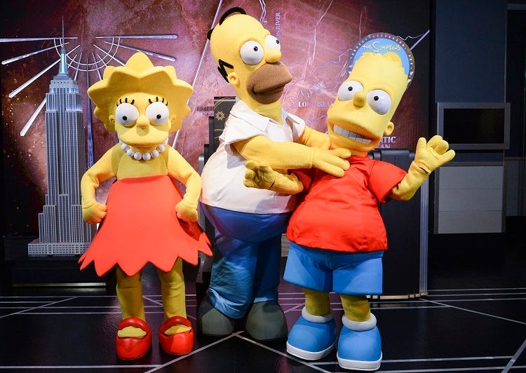 """Simpsons Costumed characters, participate in the ceremonial lighting of the Empire State Building as they attend the Empire State Building Celebration of the 30th Anniversary of FOX's """"The Simpsons"""" on December 17, 2018 in New York City. (Photo by Anthon"""