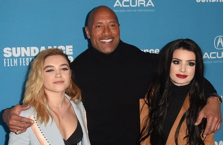 PARK CITY, UT - JANUARY 28: Dwayne Johnson, Florence Pugh, Paige, Saraya-Jade Bevis attends the Surprise Screening Of 'Fighting With My Family' during the 2019 Sundance Film Festival at The Ray on January 28, 2019 in Park City, Utah
