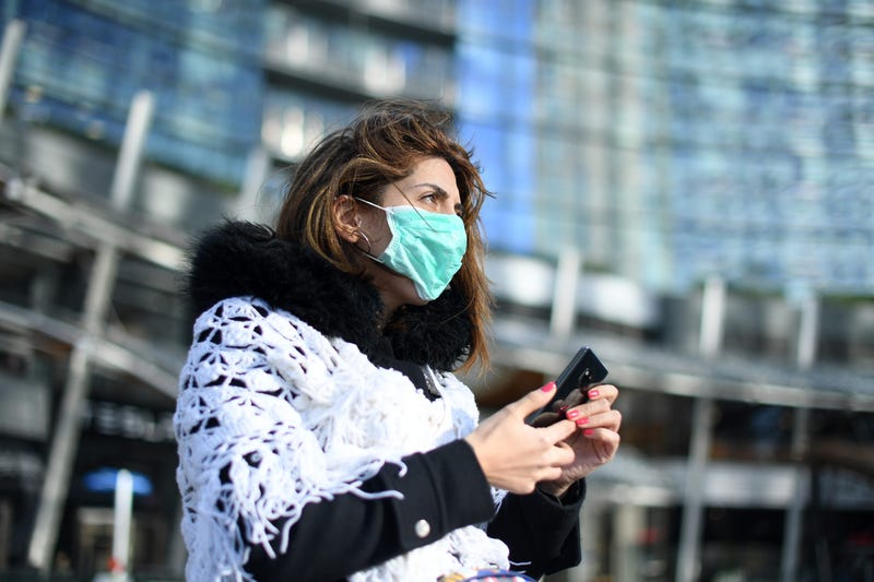 A woman wears a face mask in Milan, Italy, Feb. 26, 2020.