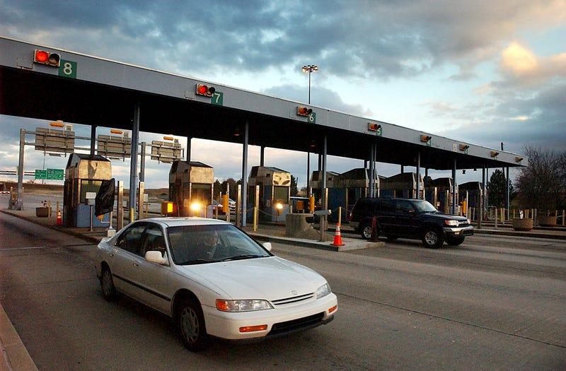 Motorists pass through Downingtown Interchange of the Pennsylvania Turnpike in Uwchlan Township in Pennsylvania, January 13, 2004. Estimates of its value vary from $2 billion to $30 billion.