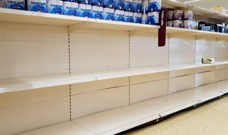 A view of empty shelves as toilet roll is almost sold out in a supermarket in Ashford, Kent. UK shoppers are stockpiling toilet paper, pasta, hand sanitiser and tinned foods as fears grow over the spread of the coronavirus.
