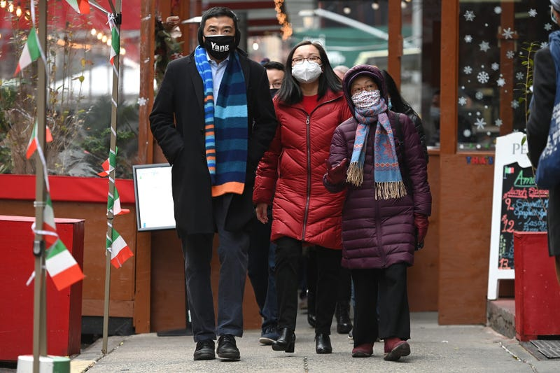 New York City Mayoral candidate Andrew Yang (l - striped scarf), candidate for NYC Council Gigi Li (center) and Council Member Margaret Chin (r) of Manhattan walk through the Chinatown neighborhood of lower Manhattan, New York, NY, January 27, 2021