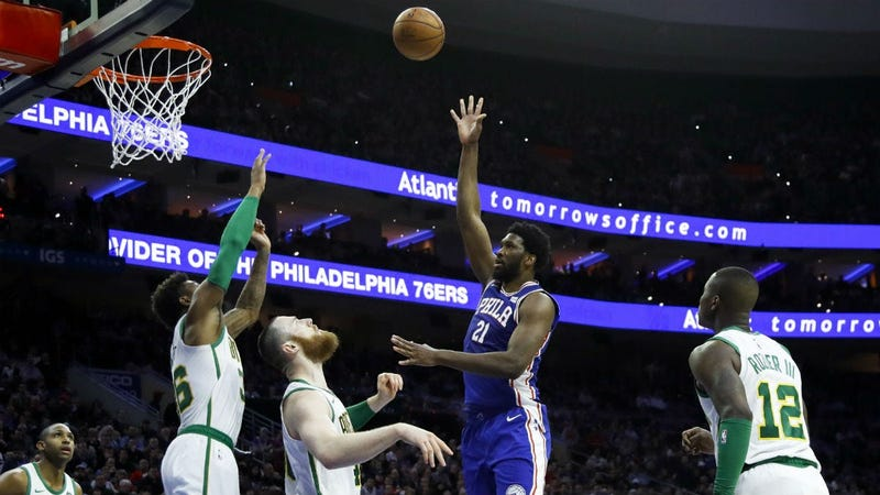 Philadelphia 76ers' Joel Embiid (21) shoots as Boston Celtics' Terry Rozier, from right, Aron Baynes, Marcus Smart and Al Horford watch during the first half of an NBA basketball game, Wednesday, March 20, 2019, in Philadelphia.