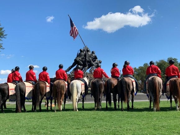 BraveHearts riders stop in front of the U.S. Marine Corps War Memorial during the Trail to Zero ride in Virginia.