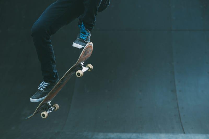 Man on skateboard jumping
