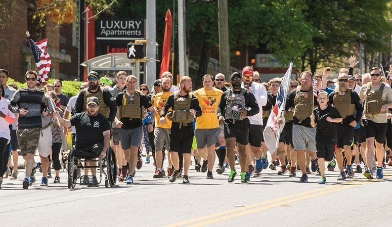 Shepherd's Men runners are joined by the crowd during a run.