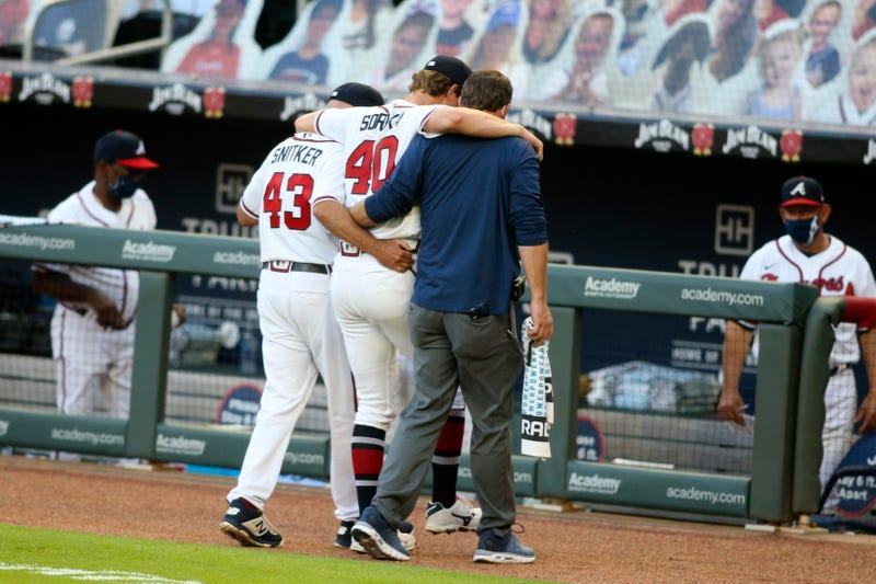 Braves' Mike Soroka is helped off the field