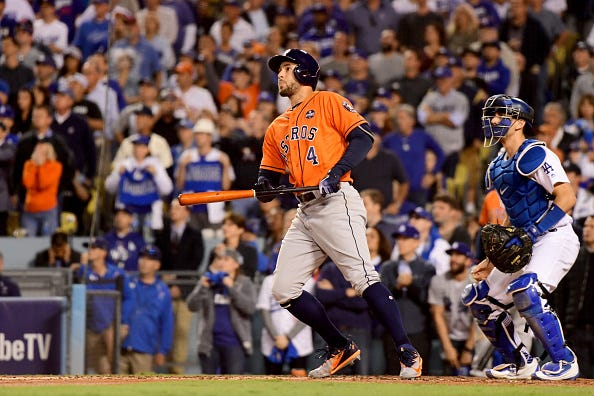 George Springer hits a home run for the Astros against the Dodgers