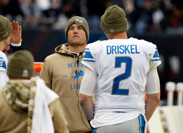 Matthew Stafford hangs on the sideline with backup Jeff Driskel.