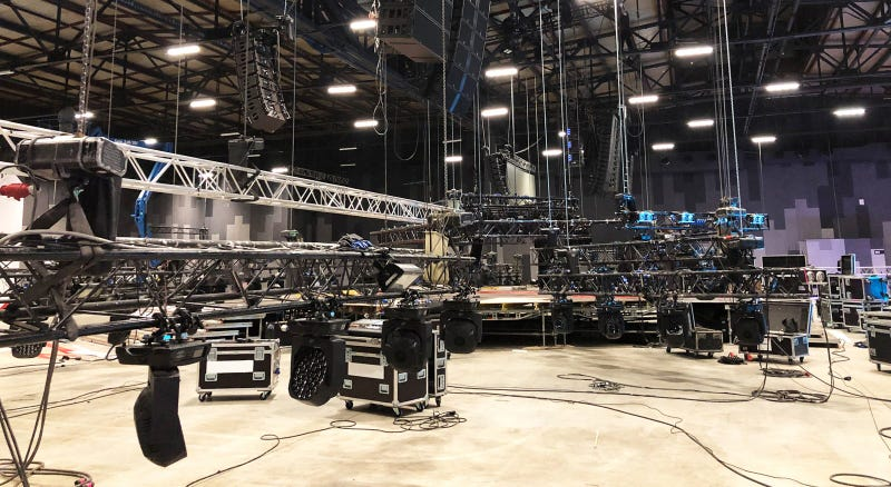 nstallation of professional sound, light, video and stage equipment for a concert. Lifting of line array speakers.