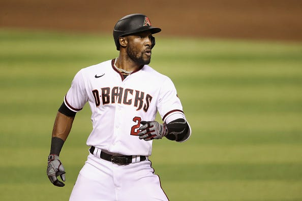 Starling Marte celebrates a hit with the Diamondbacks.