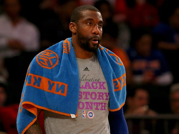 Amar'e Stoudemire watches from the Knicks' bench.