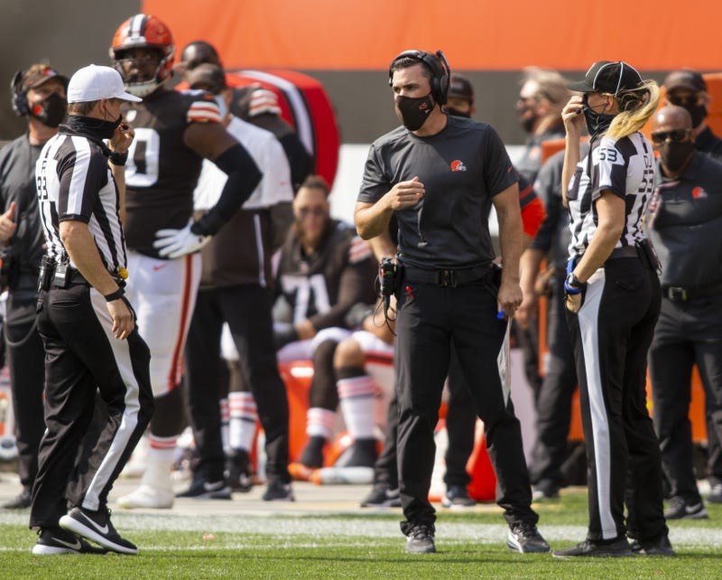 Cleveland Browns head coach Kevin Stefanski talks with referee Shawn Hochuli and line judge Sarah Thomas as he challenges a ruling on the field during a game this season.