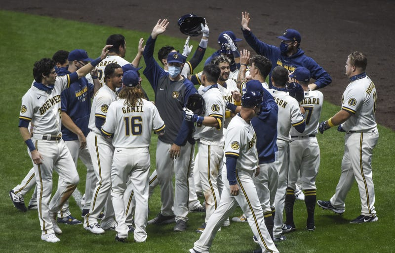 Brewers celebrate after game one walk off sac fly