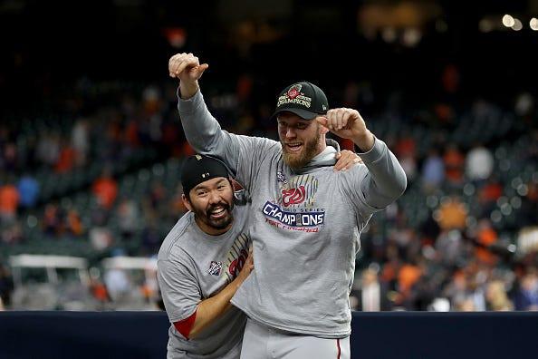 Stephen Strasburg celebrates the World Series with teammate Kurt Suzuki.