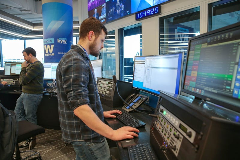 News production assistant Phillip Casey and writer Conner Barkon man the new KYW Newsradio editor's desk at 2400 Market.