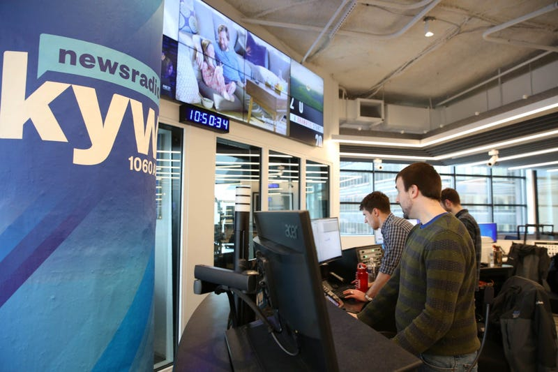 News production assistant Phillip Casey, editor Tim McLaughlin, and writer Conner Barkon man the new KYW Newsradio editor's desk at 2400 Market.
