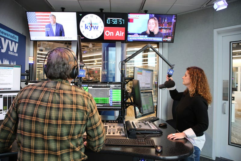 Anchors Brandon Brooks and Carol MacKenzie on the air in one of the new air studios.