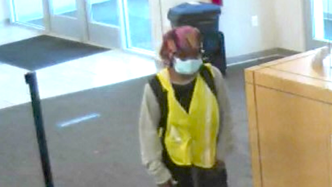 Glenesha Currie allegedly robs a Fifth-Third Bank branch Aug. 13 in suburban Summit.