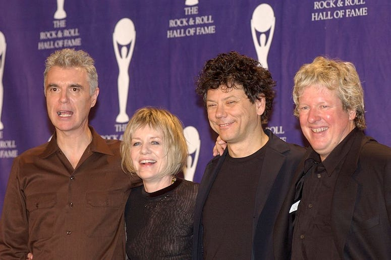 Members of the Talking Heads attend an awards ceremony.
