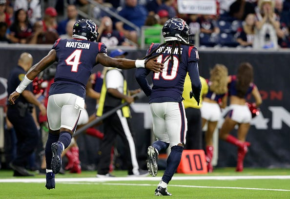 Deshaun Watson and DeAndre Hopkins celebrate a big play.
