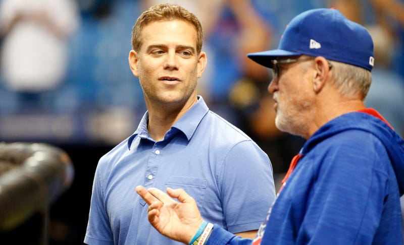 Cubs president of baseball operations Theo Epstein, left, and manager Joe Maddon